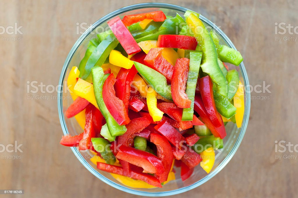 Colored peppers mixed in a bowl stock photo