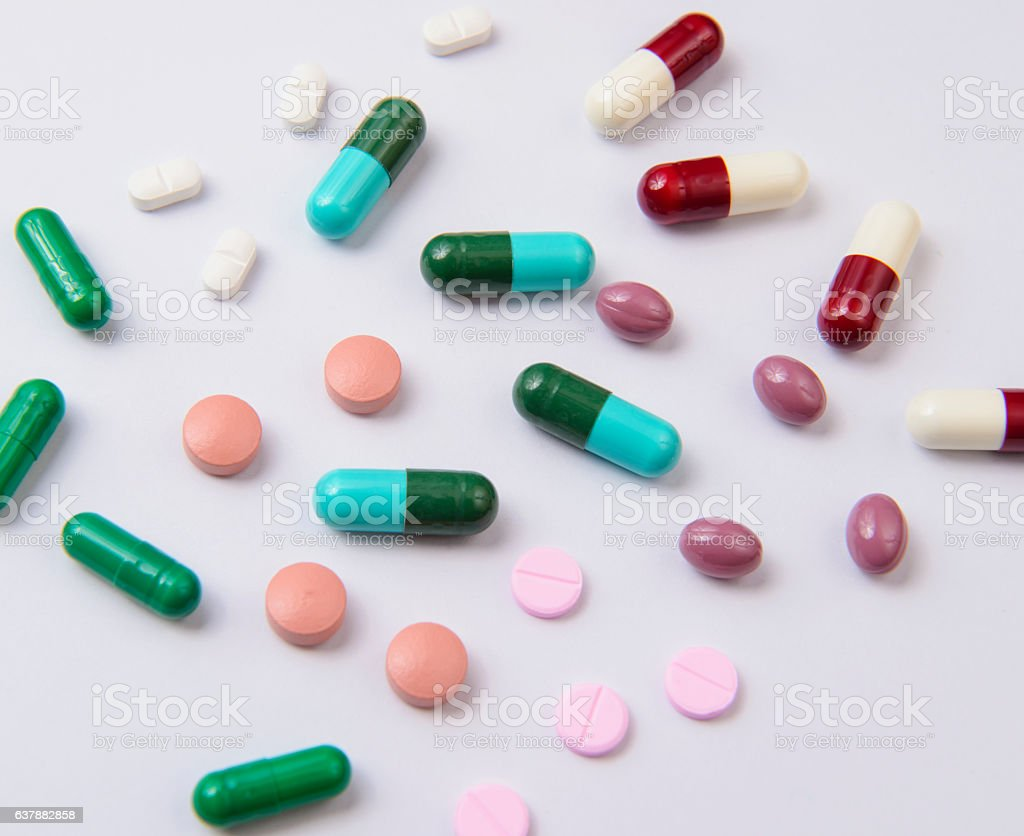 Colored pills and tablets stock photo