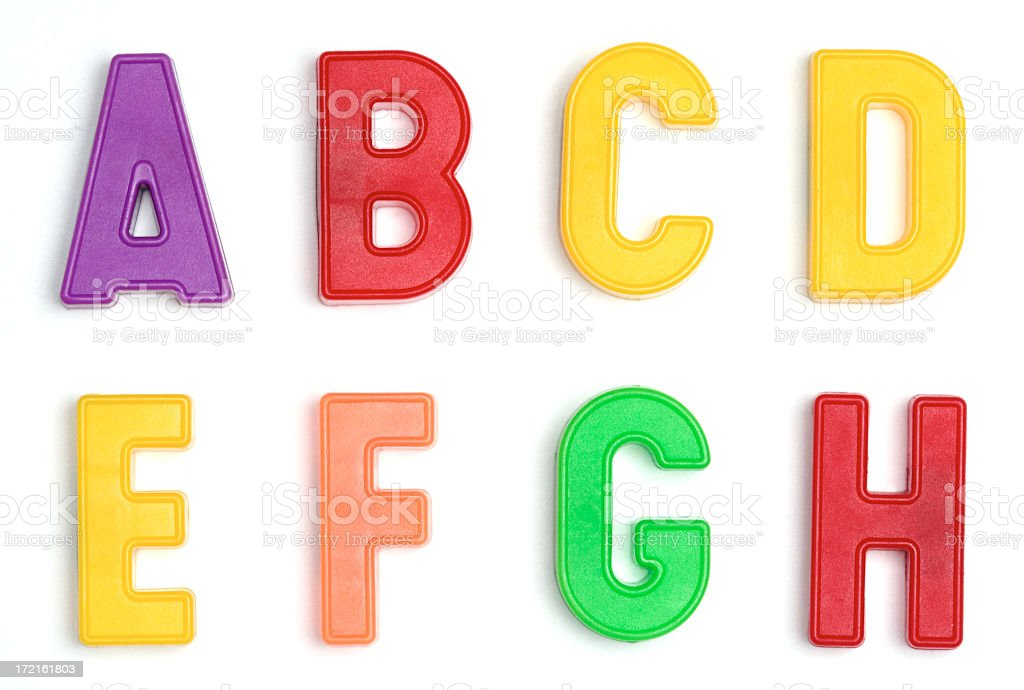 Colored plastic letters A through H stock photo