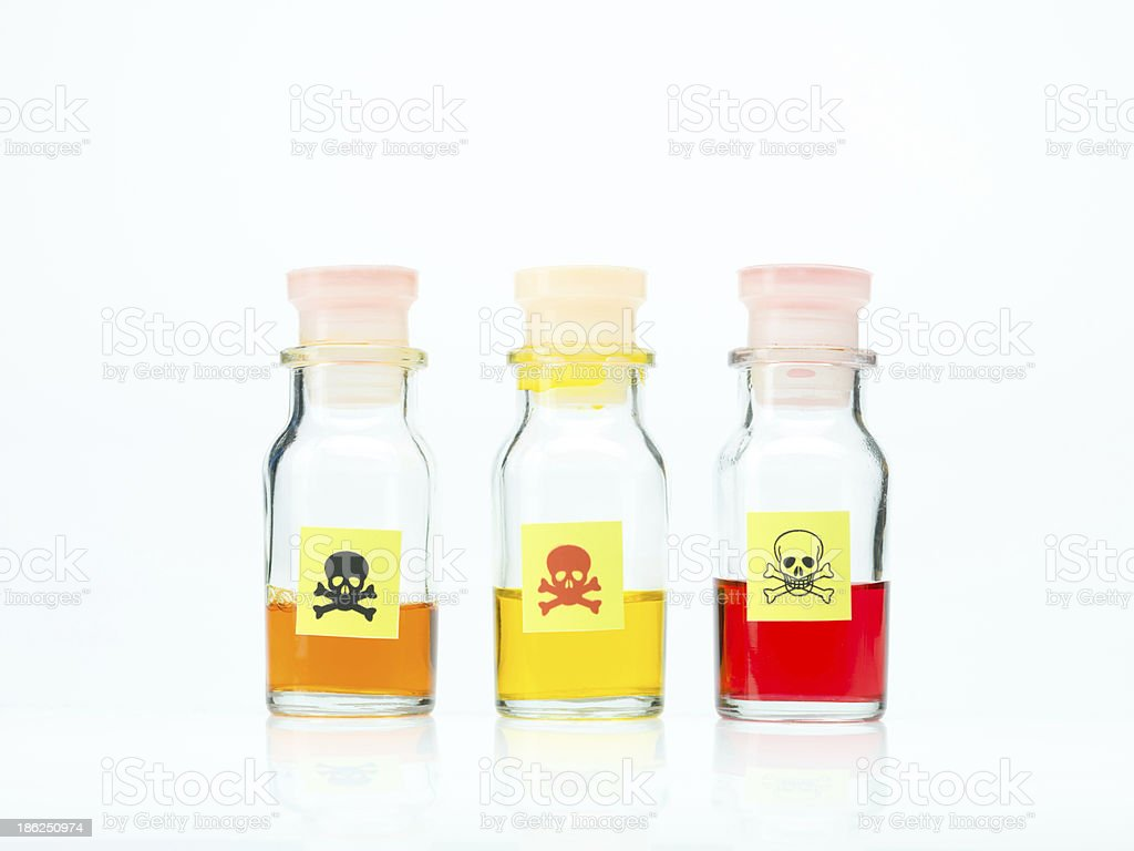 colored poisonous liquid in three different bottles royalty-free stock photo
