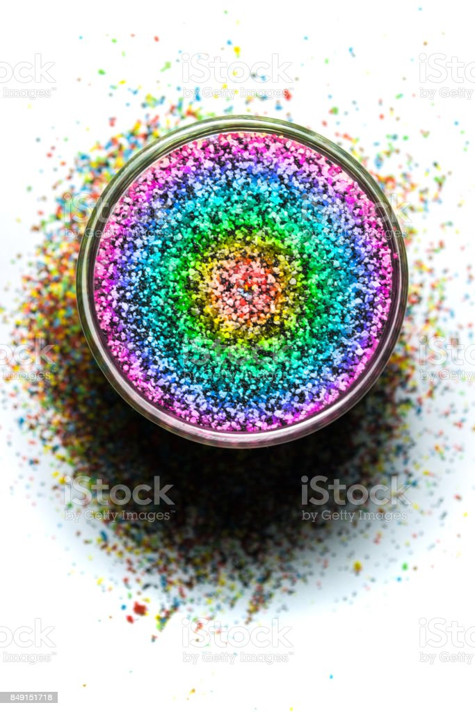 colored quartz sand, poured in a jar isolated on white stock photo