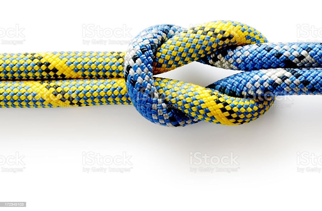 Colored rope tied in a knot on a white background stock photo