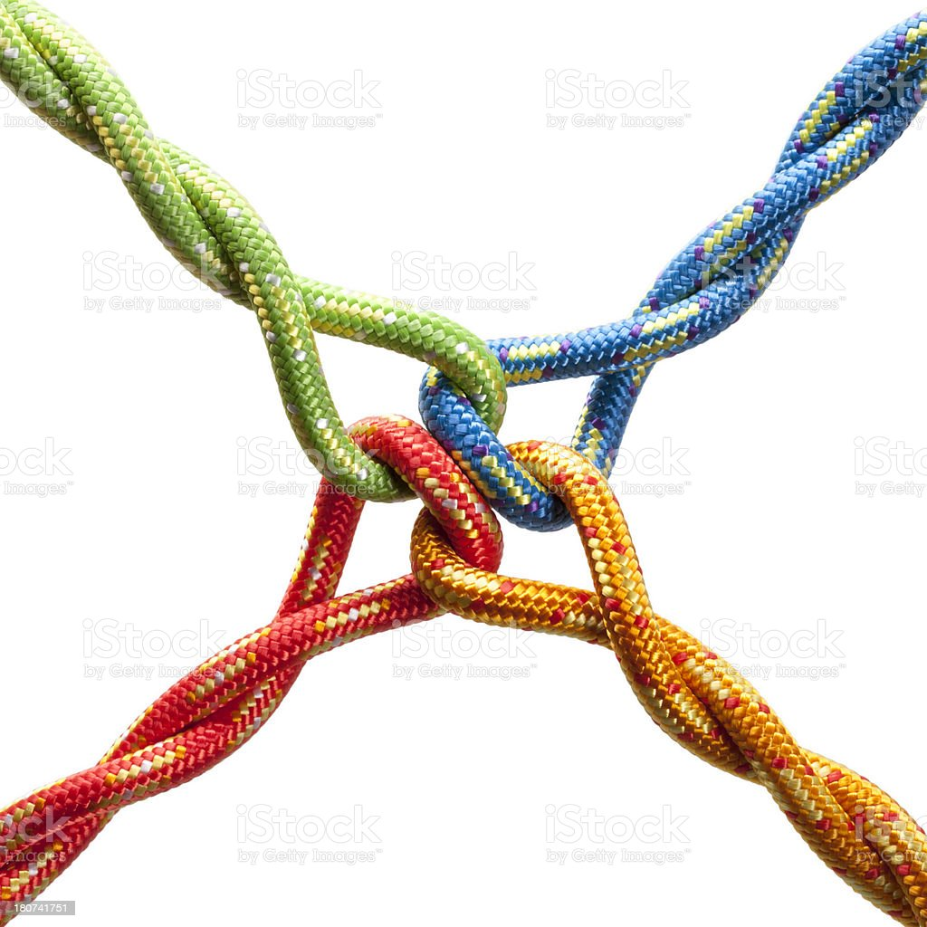 Colored ropes tied into a knot stock photo