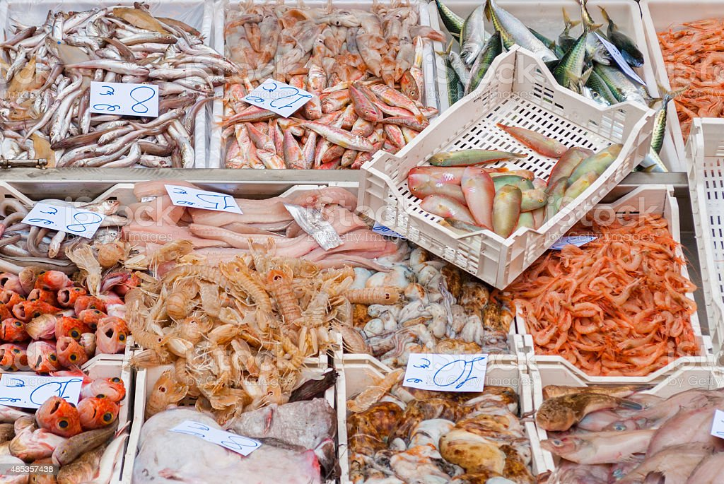 Colored seafood in the fish market of Catania (Sicily) stock photo