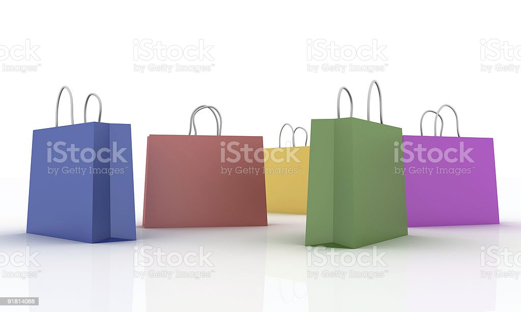 Colored shop bags on a white plan royalty-free stock photo