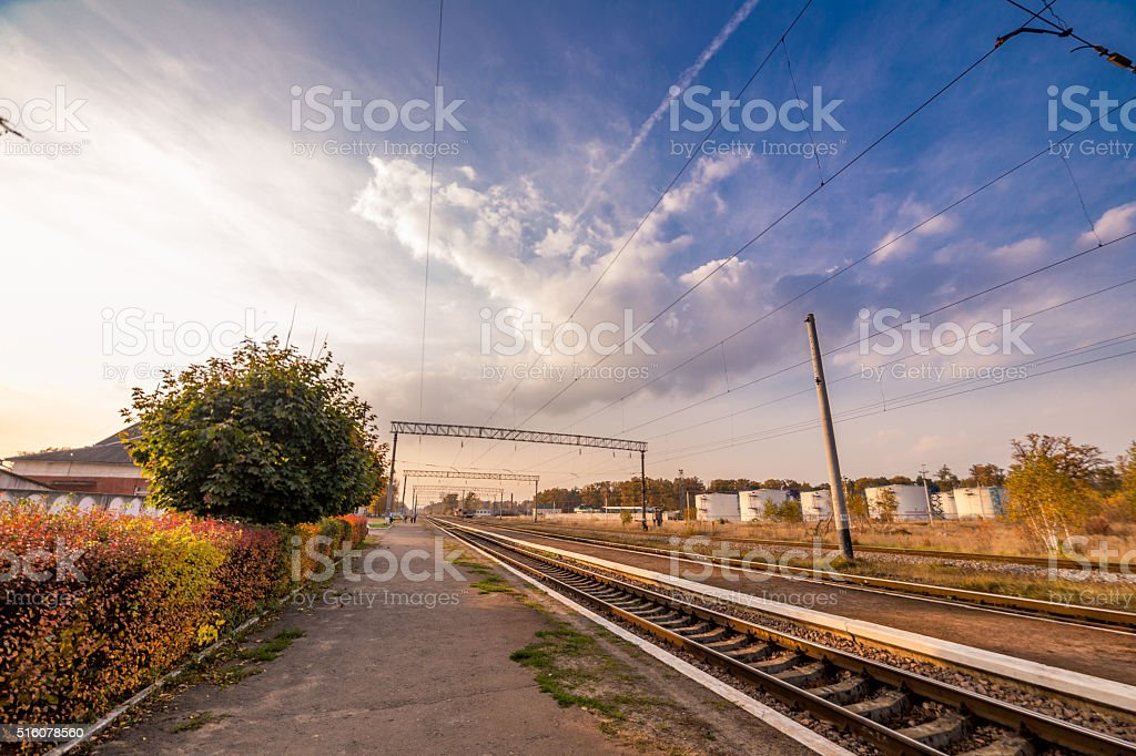 Colored sky at rail station stock photo