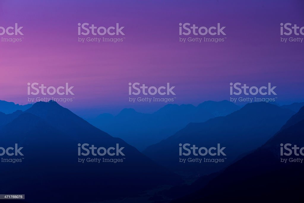 colored sky behind mountains at sunrise royalty-free stock photo