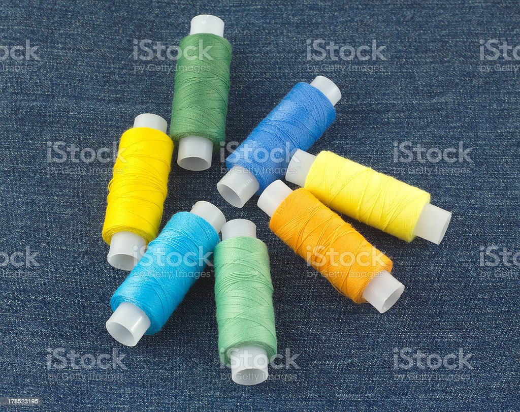 Colored spools with threads close up royalty-free stock photo