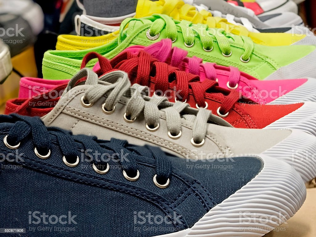 colored sports shoes, rubber and canvas stock photo
