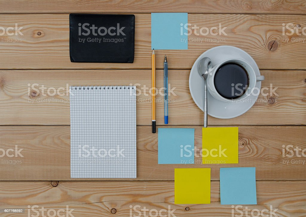 colored stickers cup of coffee pen notebook and wallet stock photo