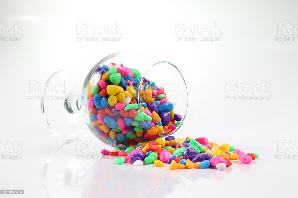 Colored stones in a glass. stock photo
