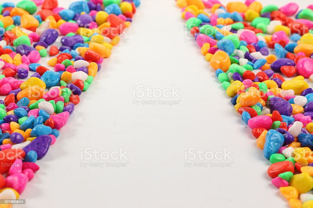 Colored stones on a white background. stock photo