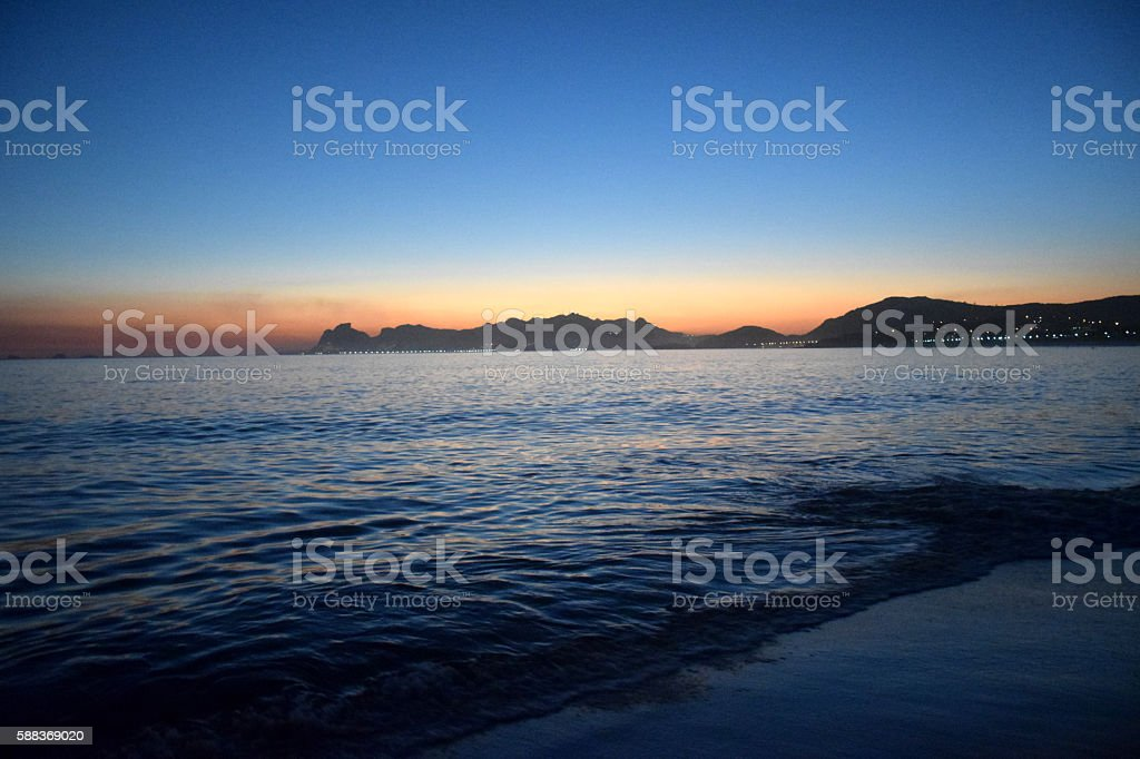 Colored sunset on the beach in Rio de Janeiro stock photo