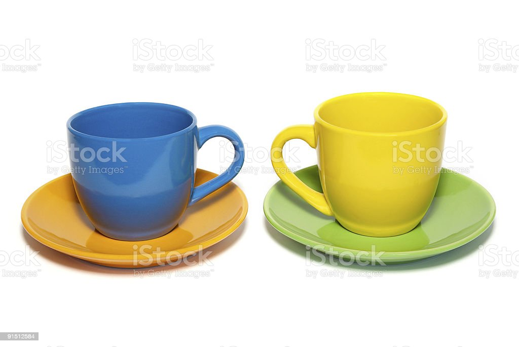 Colored teacups and saucers isolated on white. royalty-free stock photo