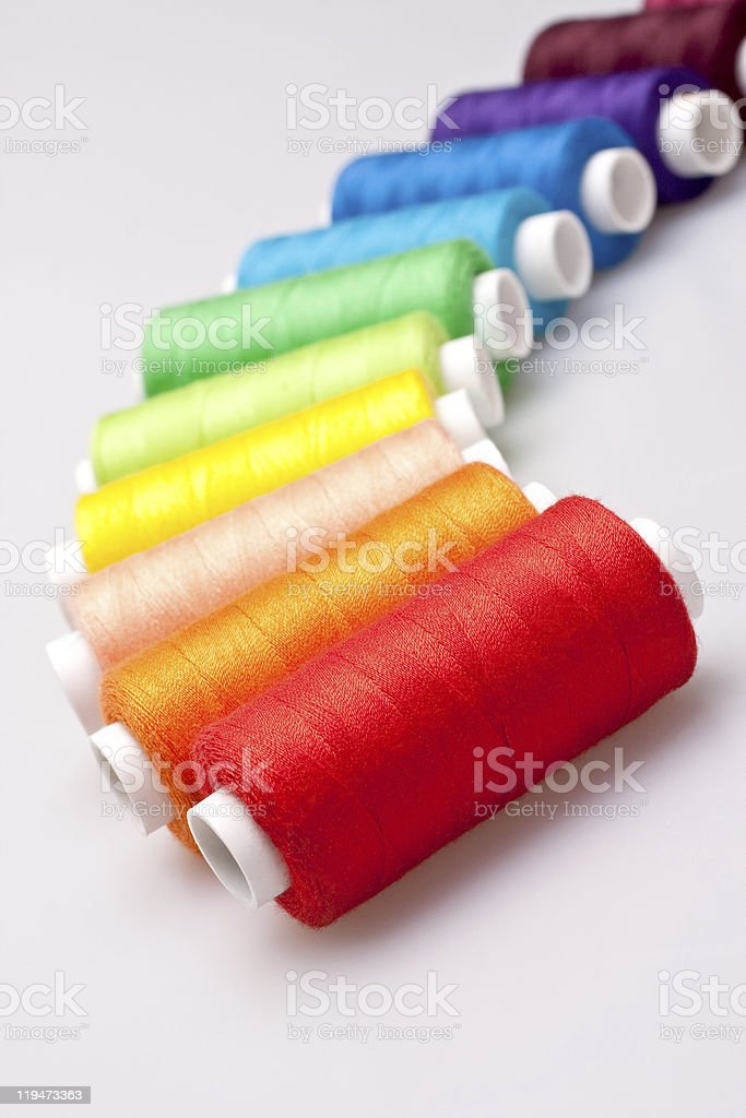 colored thread for sewing stock photo