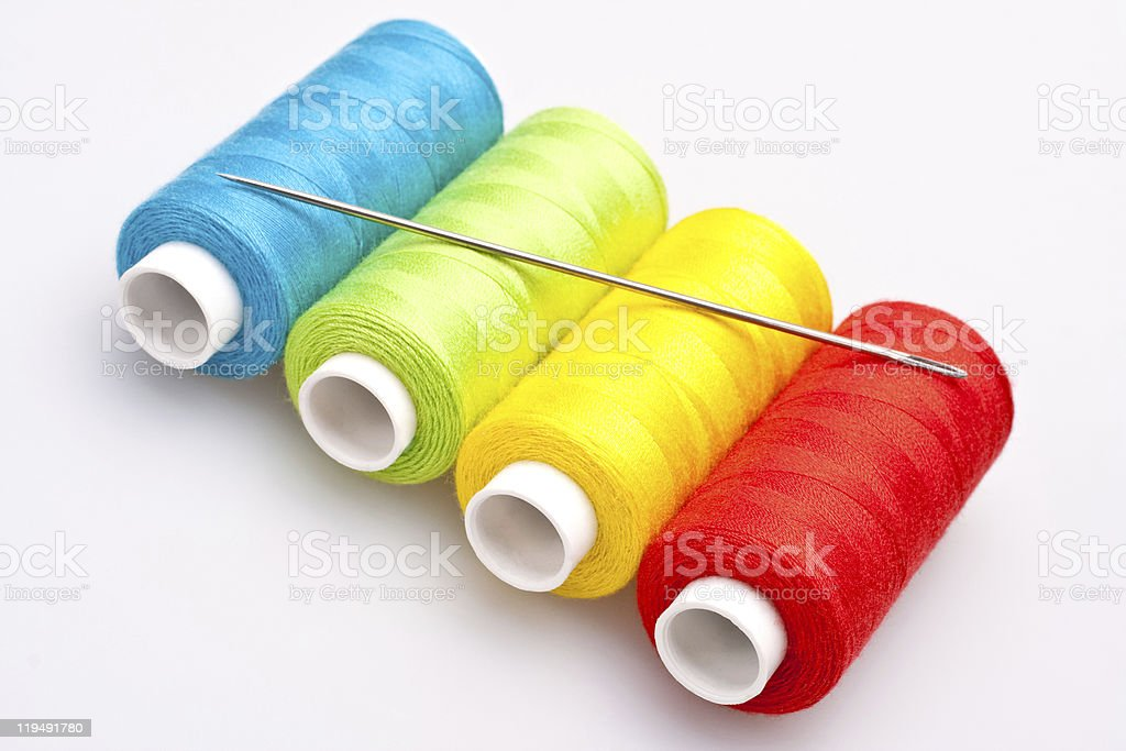 colored thread for sewing with needle royalty-free stock photo