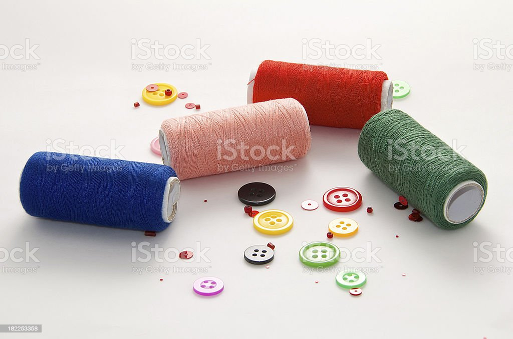 Colored Threads and Buttons on White Background royalty-free stock photo
