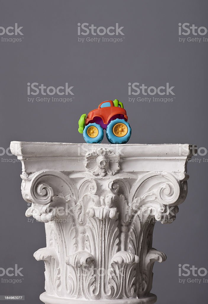 colored toy on a corinthian capital royalty-free stock photo