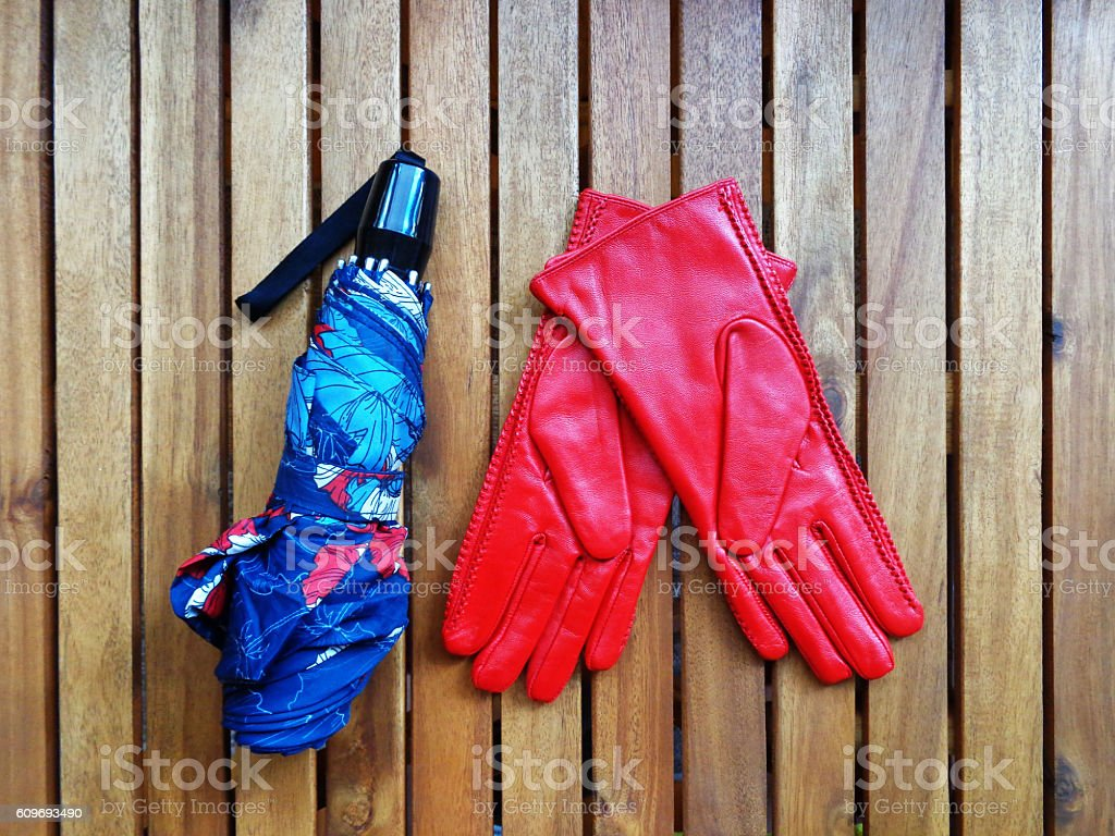 Womens colored leather gloves - Colored Umbrella And Red Womens Leather Gloves Royalty Free Stock Photo