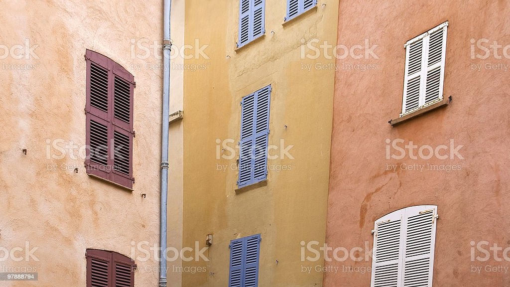 Colored windows in three facades royalty-free stock photo