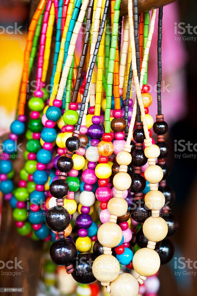 Colored wooden pearl necklaces stock photo