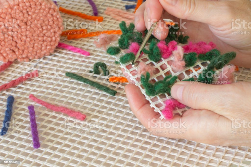 Colored woolen a thread for rug weaving hook. Handmade stock photo
