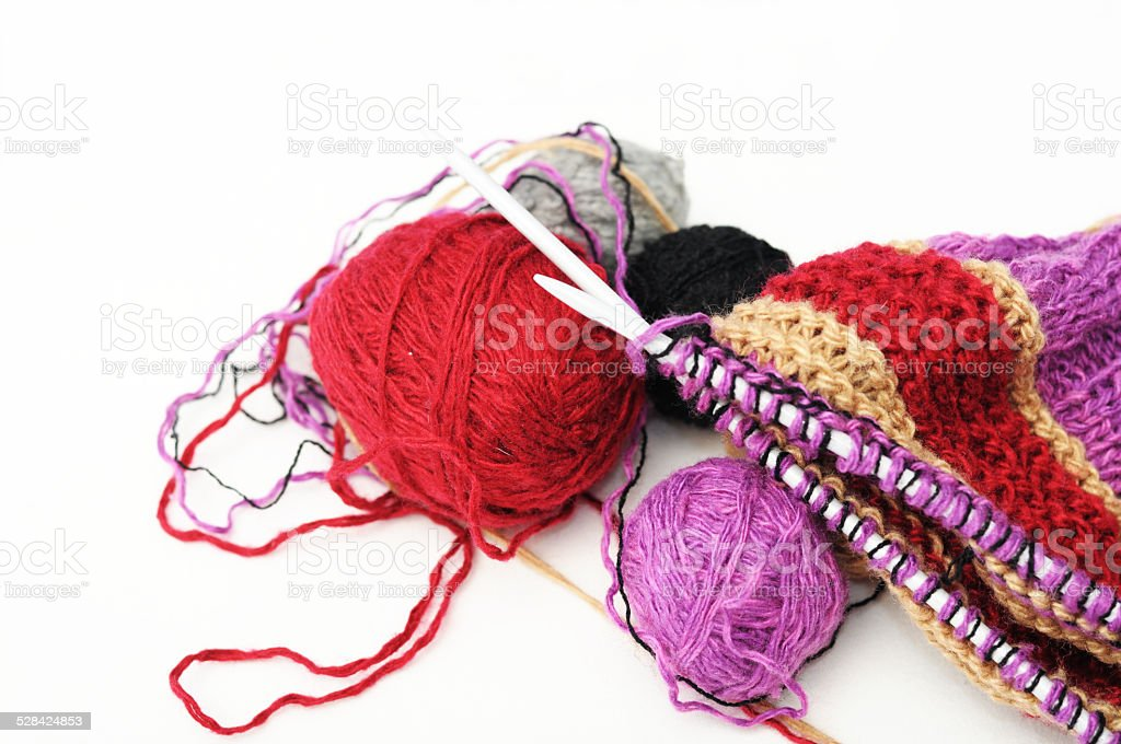 Colored woolen yarns and knitting stock photo