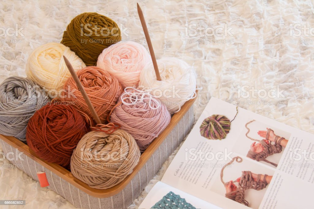 Colored yarn and knitting needles in box. stock photo