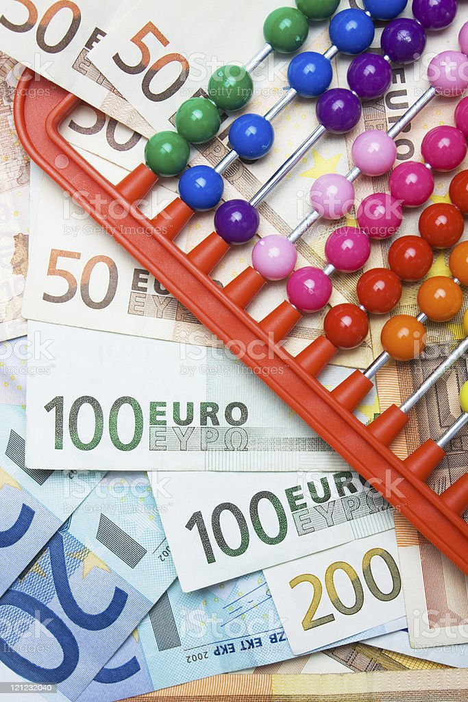 Colorful abacus and european money stock photo