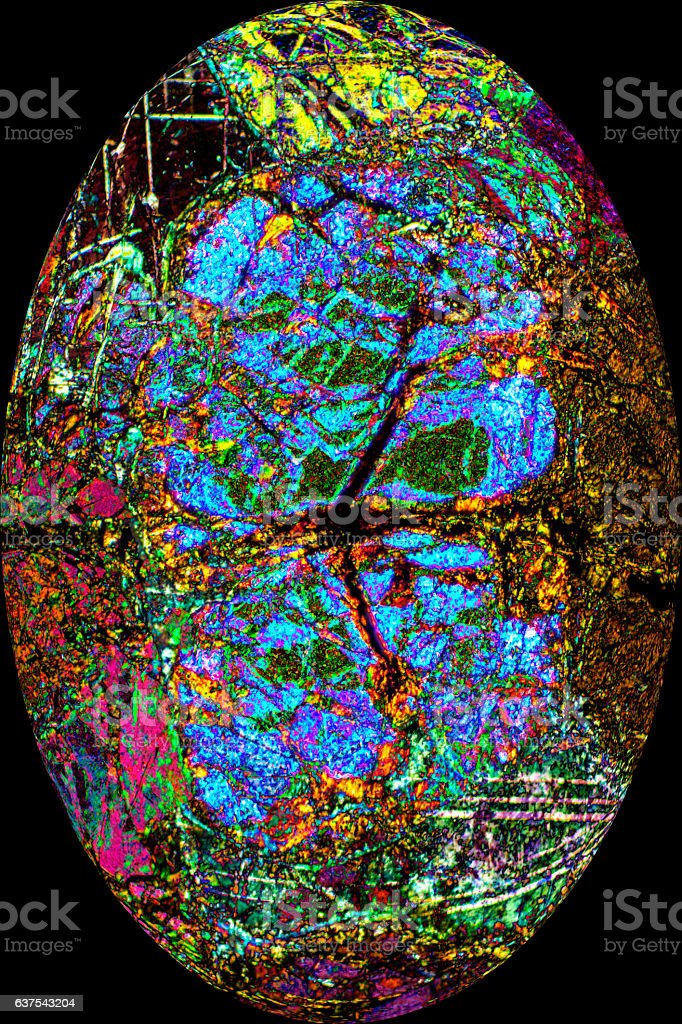 Colorful, abstract egg from polarizing micrograph of a mineral. stock photo