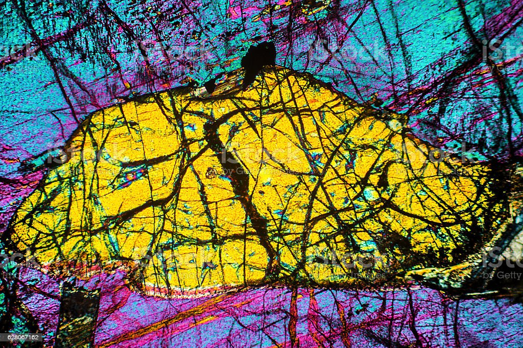 Colorful, abstract pattern of mineral in a polarizing micrograph stock photo