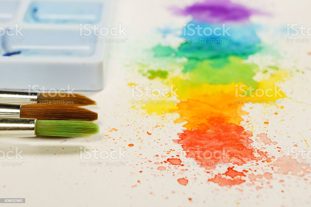 colorful abstract watercolor painting with brushes stock photo