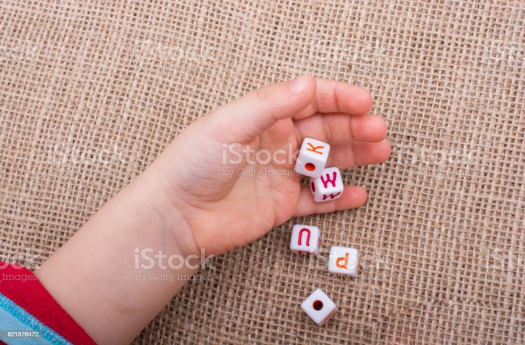 Colorful alphabet letter cubes in hand stock photo
