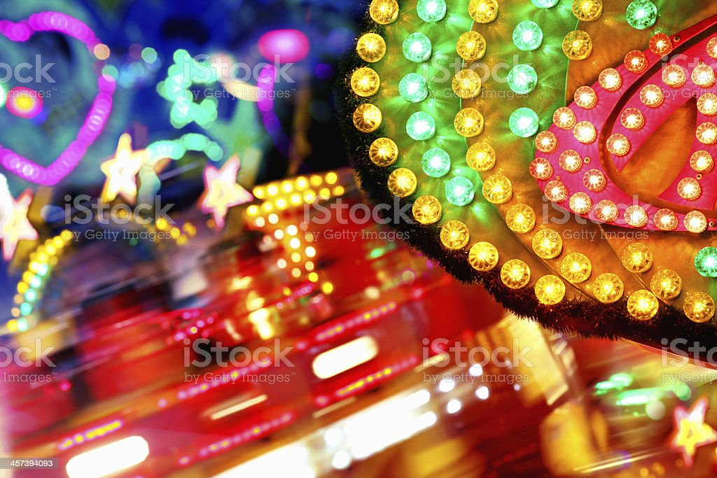 Colorful amusement park funfair lighting with vibrant light bulbs background stock photo