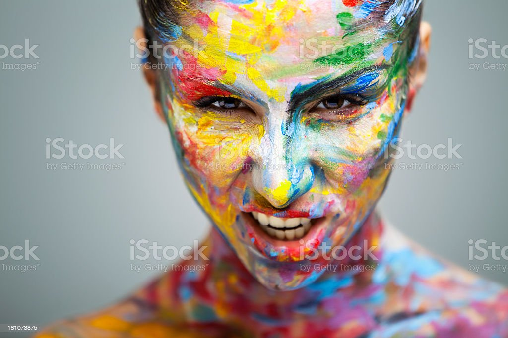 A colorful and beautiful woman in splattered paint royalty-free stock photo