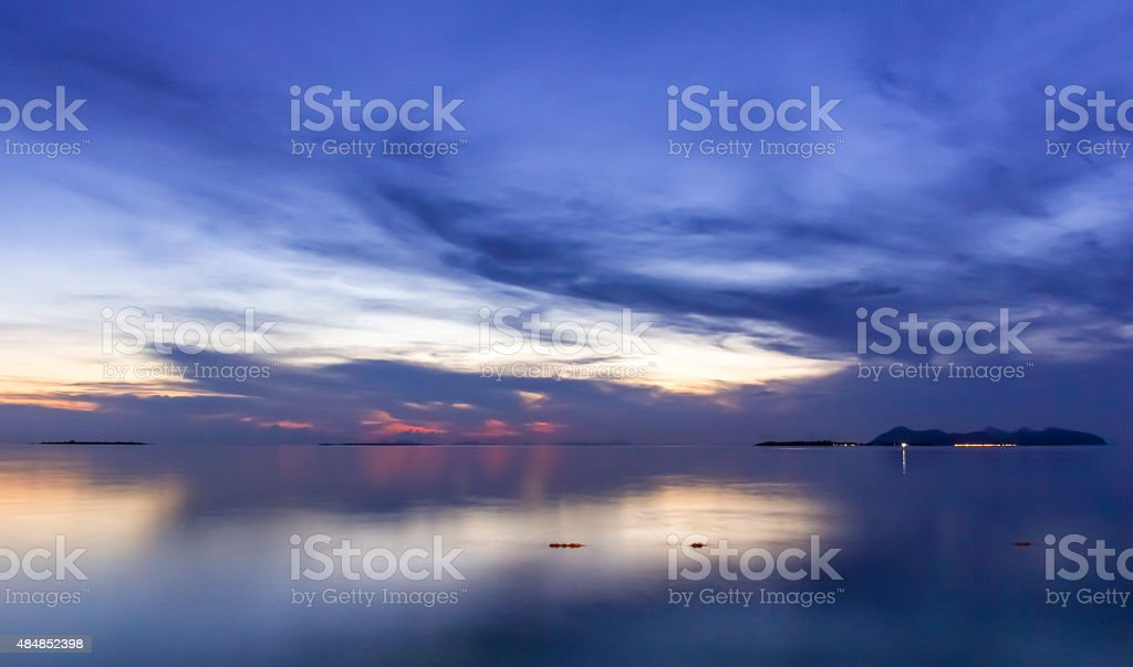 Colorful and peaceful evening at seaside with cloud. stock photo