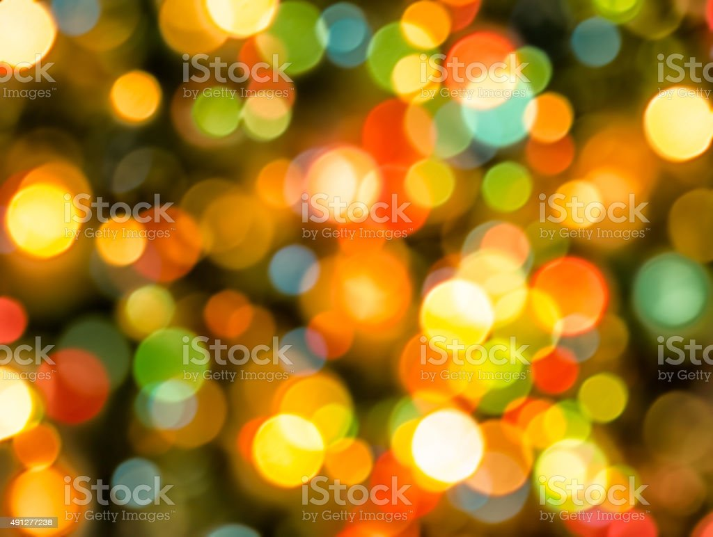 Colorful and sparkly defocused christmas lights background stock photo