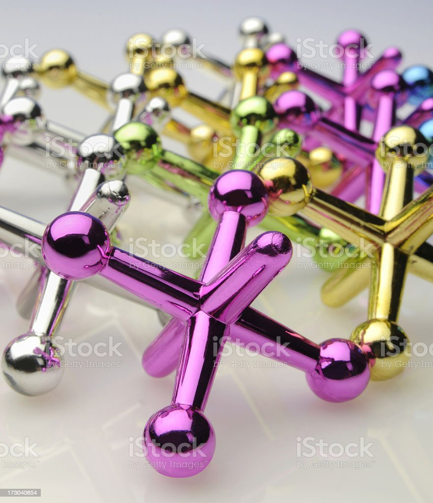 Colorful Anodized Shiny Reflective Jacks Game; Gold, Green, Magenta, Cyan royalty-free stock photo
