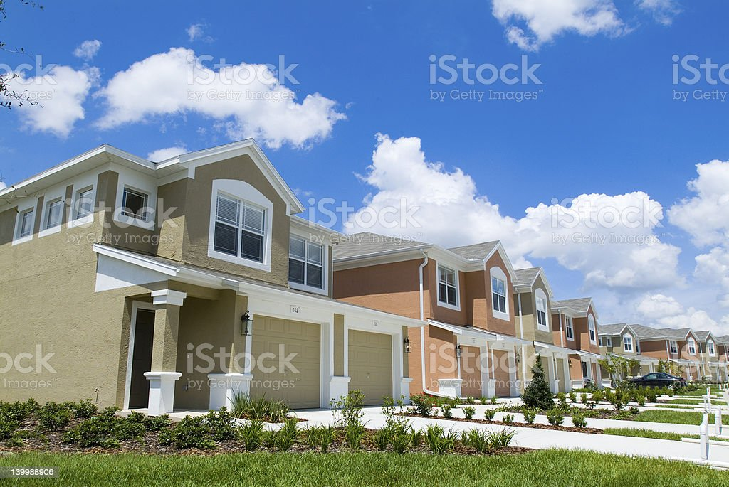 Colorful apartment condos with bright blue sky stock photo