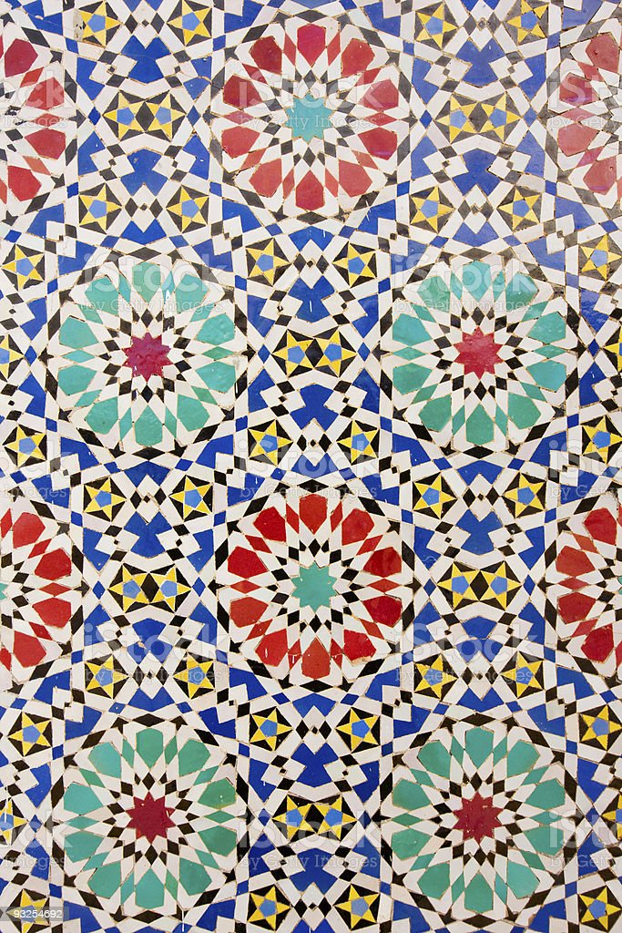 Colorful Arab mosaic with printed stars and wheels royalty-free stock photo