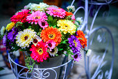 Colorful artificial flower bouquet decorated in basket