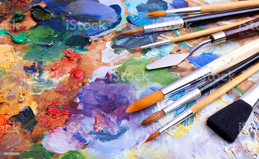 Colorful artist brushes and paint stock photo