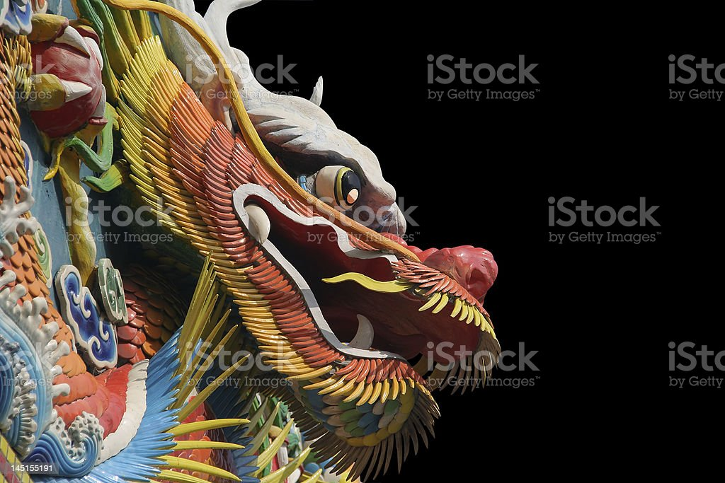 A colorful Asian temple dragon on a black background royalty-free stock photo