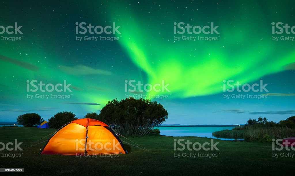 Colorful aurora boreal in green and blue over Iceland stock photo