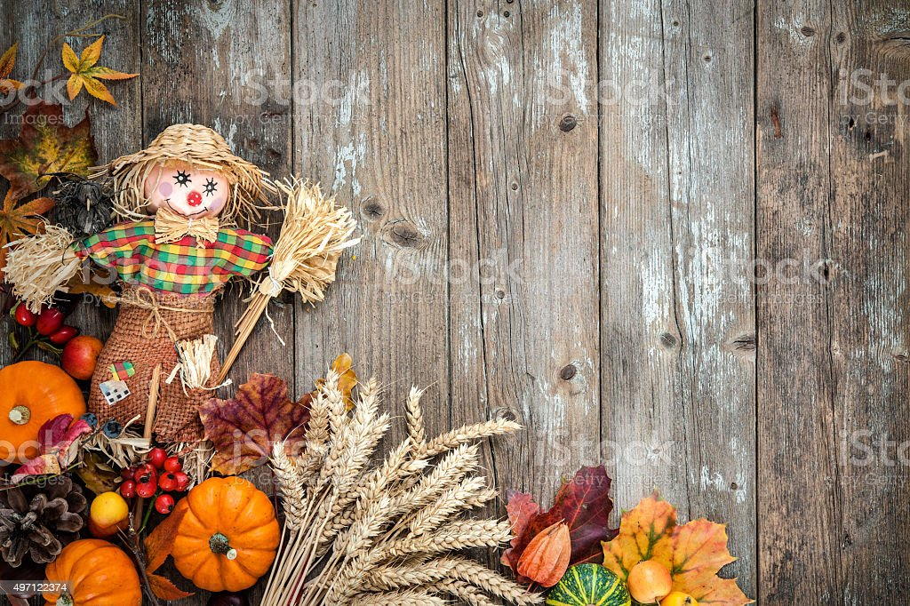 Colorful autumn background with a scarecrow stock photo