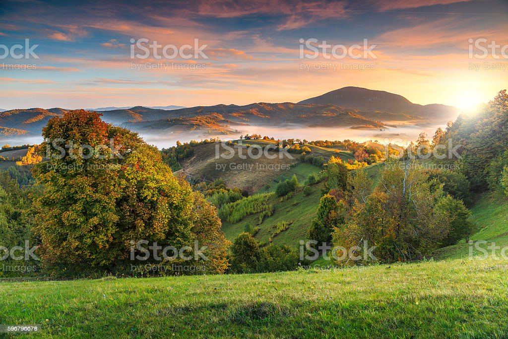 Colorful autumn landscape with misty valley,Holbav,Transylvania,Romania,Europe stock photo