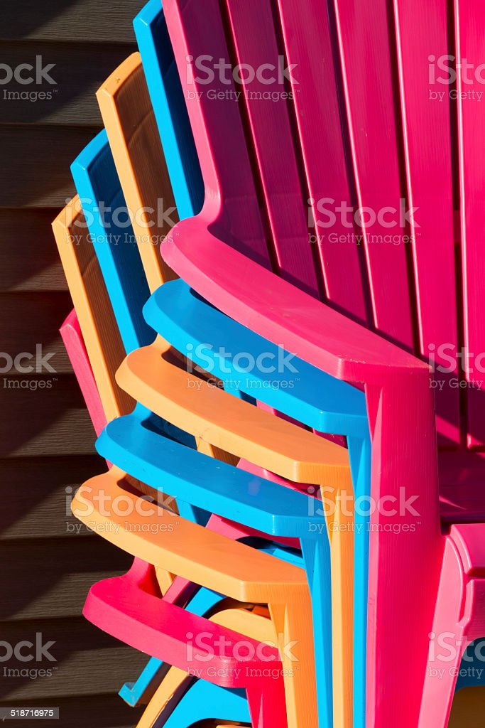 Colorful Autumn Lawn Chairs Stacked for the Winter stock photo