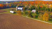 Colorful Autumn rural forest and farm landscape.