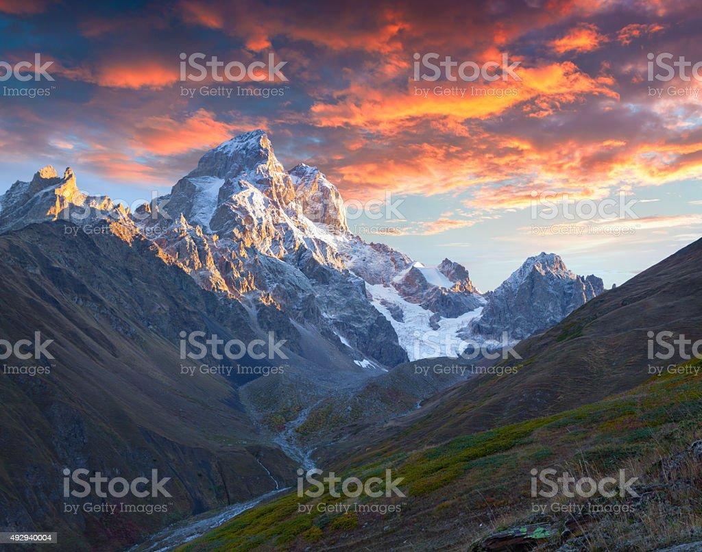 Colorful autumn sunrise in the Caucasus mountains. stock photo
