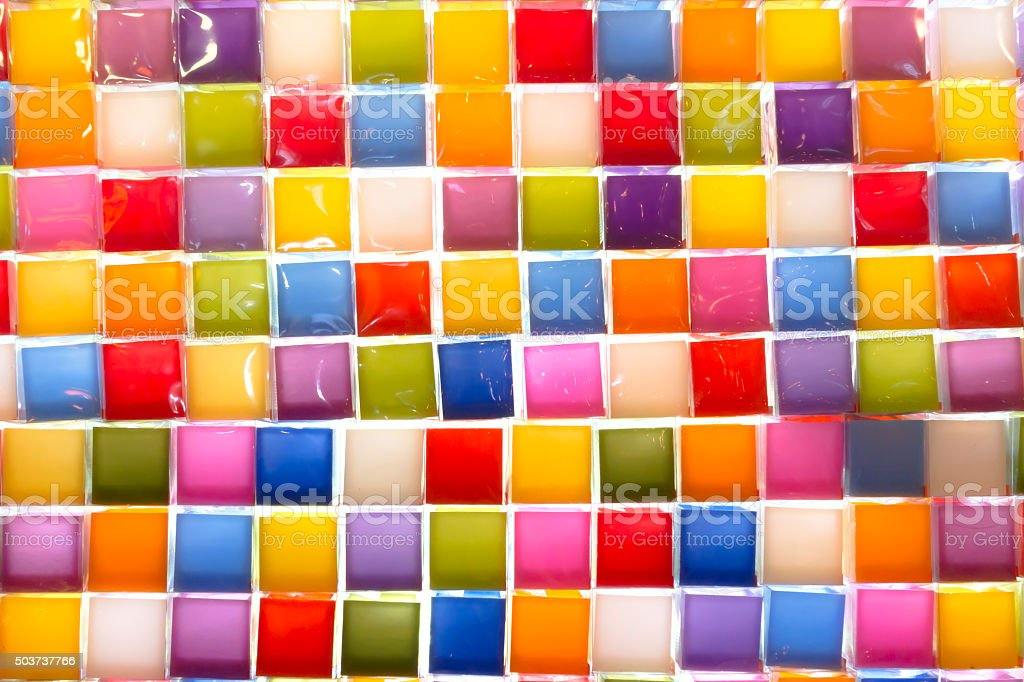 Colorful background.  Colored candles wrapped in plastic royalty-free stock photo